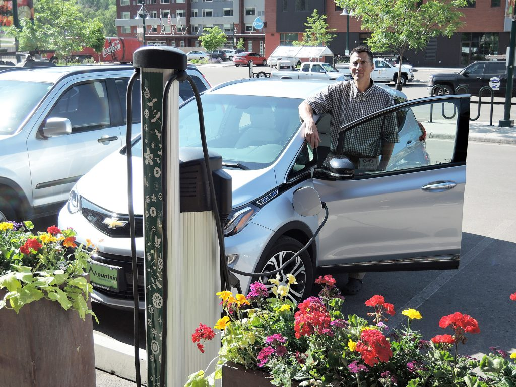 Chris Lane shows his new Chevy Bolt at the public EV charger at Whole Foods Market in Basalt.