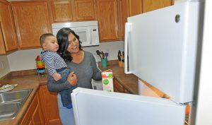 The CARE program provided a new energy-efficient refrigerator for Cristal Aguirre Anchondo and her son Jonathan, 7 months.